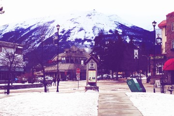 A view down snowy Patricia Street in the town of Jasper. Whistlers Mountain is in the background.