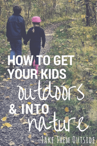 two children holding hands walking in the forest, text reads how to get your kids outdoors and into nature