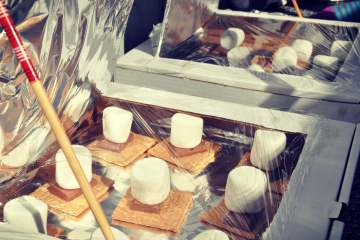 Handmade pizza box solar ovens for cooking smores in your backyard