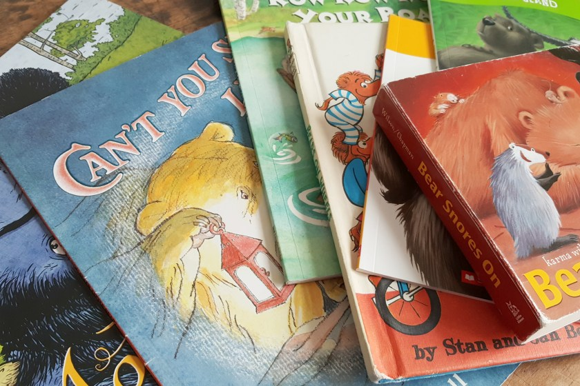 a stack of bear books for kids