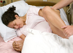 pregnant woman lying on side during labor