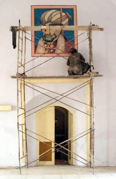 Artist Moheb works in his studio in Kabul, Afghanistan.