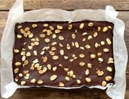 Chocolate Peanut Butter Biscuit Bars packed full of peanut butter deliciousness, topped with dark chocolate to cut through the sweetness and last of all, an extra peanut hit with salty, crunchy peanuts. A perfect treat for Peanut Butter fans!