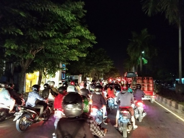 Traffic in Bali is very busy with scooters in tourist areas