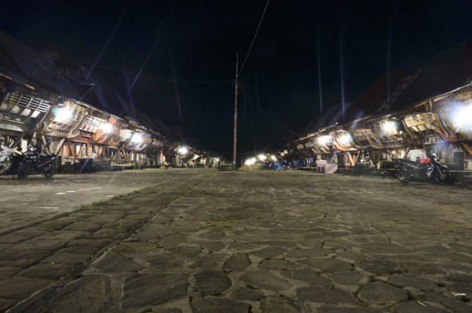 Street at night showing the signature architecture of a village in Bawomataluo