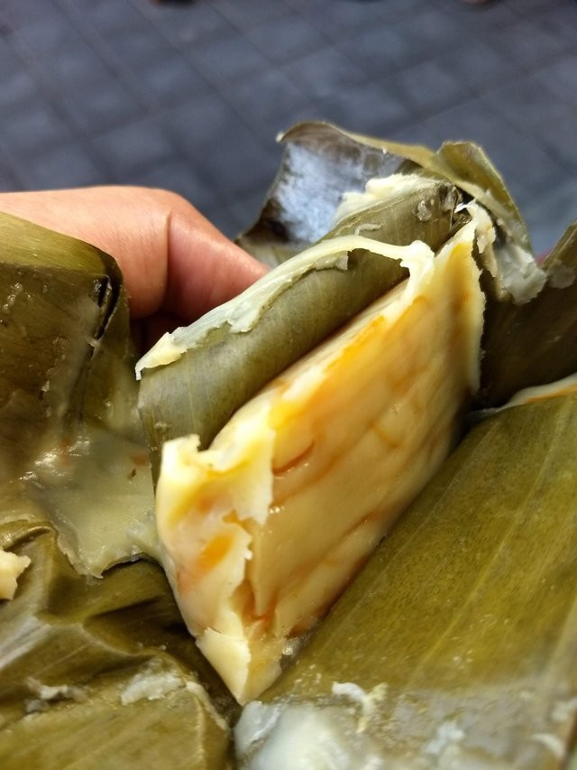 Simpang, a sweet tasty pudding like snack wrapped in Banana leaf