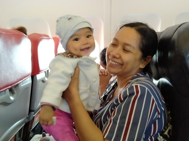 smiling baby on airasia flight