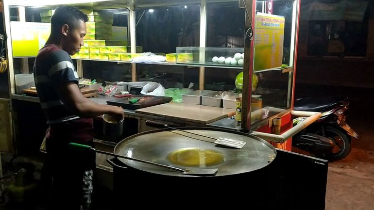 stirring process of the filling for Martabak