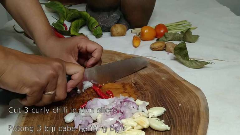 cutting chilies for my spicy potato recipe