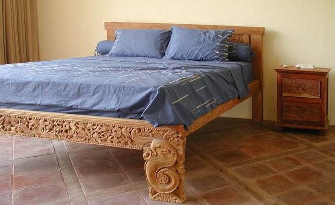 Bed made from teak wood with carvings