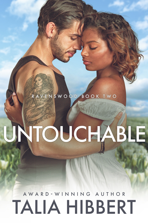 Untouchable by Talia Hibbert: a black woman in a white dress and a tattooed, pierced white man hold each other close against a backdrop of blue skies and white tulips.