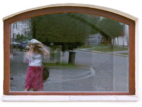 Taliya Finkel mirrored in window