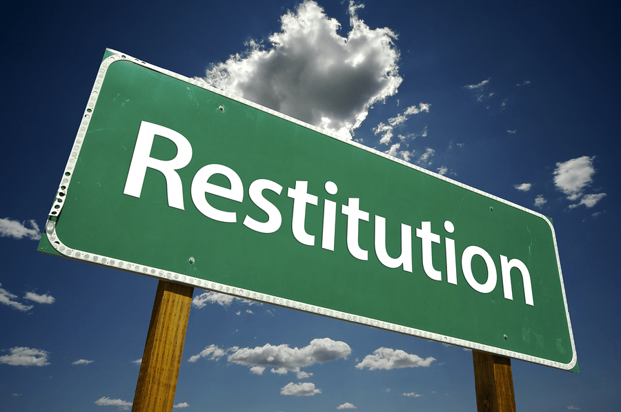 What does Restitution mean in UK law?