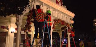 Putting up Magic Kingdom Fall Decorations