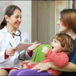 16545545 - friendly mature children's doctor examining baby in home
