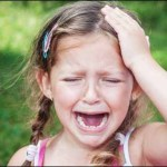 34735313 - young girl crying: because of headache