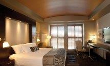 Deluxe King Two Queen Hotel Room