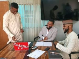Banky w signs Mike and Wife