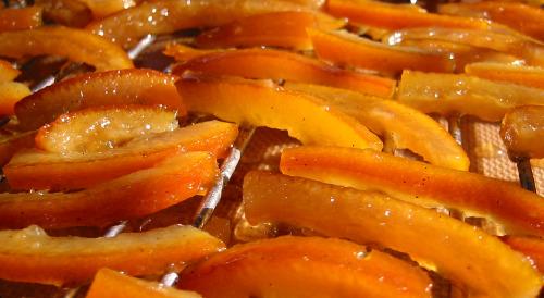 candied orange peels drying