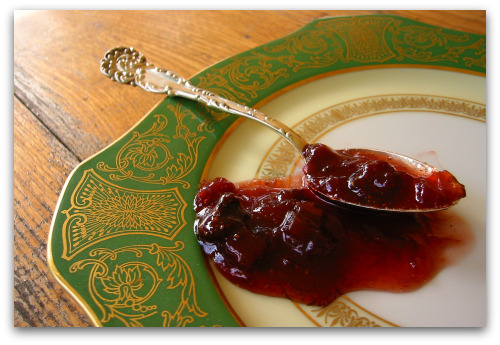 strawberry rhubarb jam spoonful on a plate