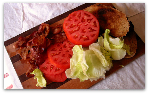 fresh tomatoes and the fixings for a homegrown BLT