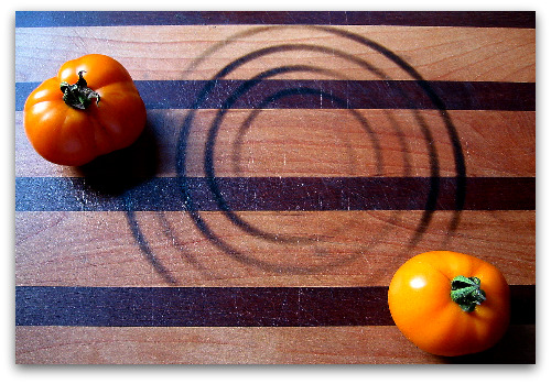 cutting board and tomatoes
