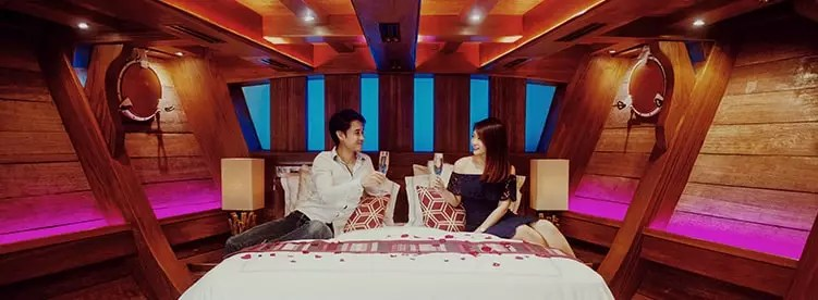 couple inside the cabin having champagne royal albatross