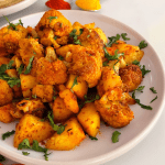 Curried Cauliflower and Potato cooked in the oven