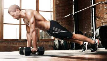 man-doing-dumbbell-pushups