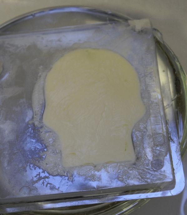 skull butter in mold hot water