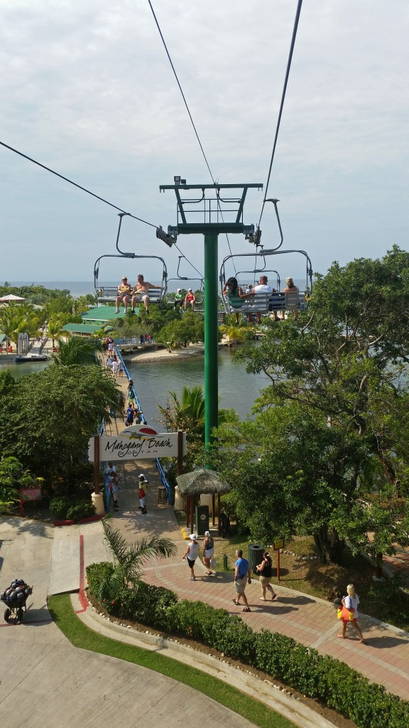 taking chairlift to Mahogony Beach in Roatan