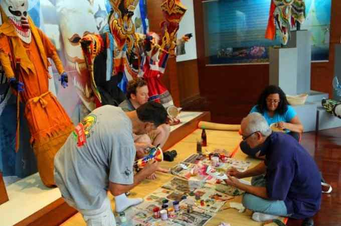 Visiting the Phi Ta Khon Museum and attempting to paint a Ghost Mask