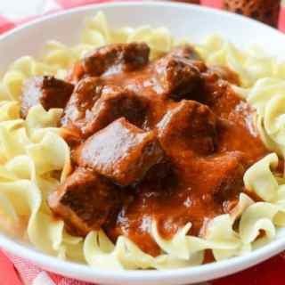 Crock Pot Beef Goulash is the perfect comfort food recipe! So easy to make with the slow cooker! Thick and hearty this recipe is a family favorite! Served with egg noodles and perfect for leftovers. You could also serve this with rice or your favorite pasta!
