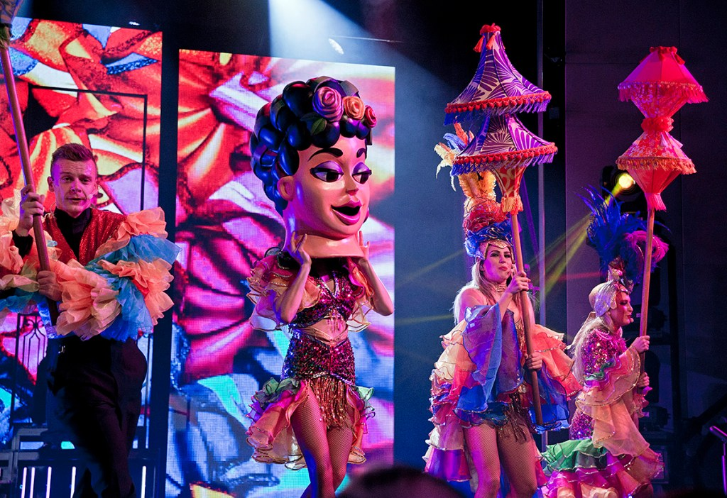 "Carnival Vista singers and dancers perform ""Amor Cubano"" that combines Latin songs with current hits and features a seven-piece Cuban-inspired band in the ship's Liquid Lounge. The largest and most innovative cruise vessel in Carnival Cruise Line's fleet, Carnival Vista measures 133,500 tons, 1,055 feet long and has a guest capacity of almost 4,000 passengers. Photo by Andy Newman/Carnival Cruise Line"