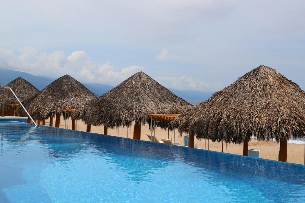 sitting-in-the-infinity-pool-villa-premeire-puerto-vallarta-mexico