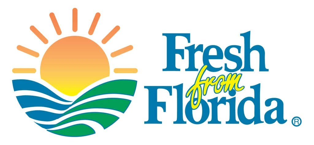 Logo featuring a sun over fields of produce