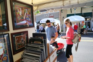 Visitors browse artwork from over 120 fine artists and craftsmen