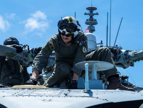 Lt. Richard Wheeler, from Bradenton, FL., conducts pre-flight checks on a MH-60S Sea Hawk helicopter
