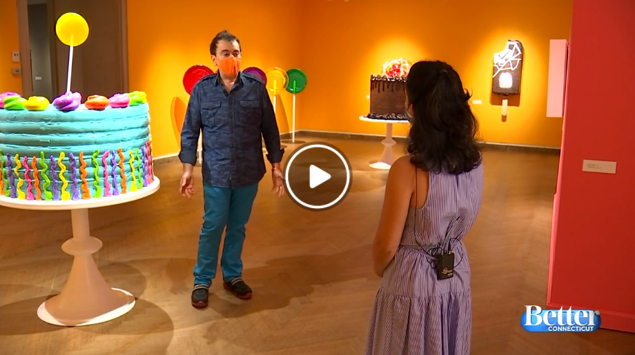 Peter Anton stands in Lyman Allyn Art Museum among his large confectionery sculptures