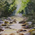 watercolor painting of rock filled stream in the mountains