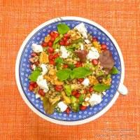 Tricolor quinoa salad with pomegranate, walnuts and feta