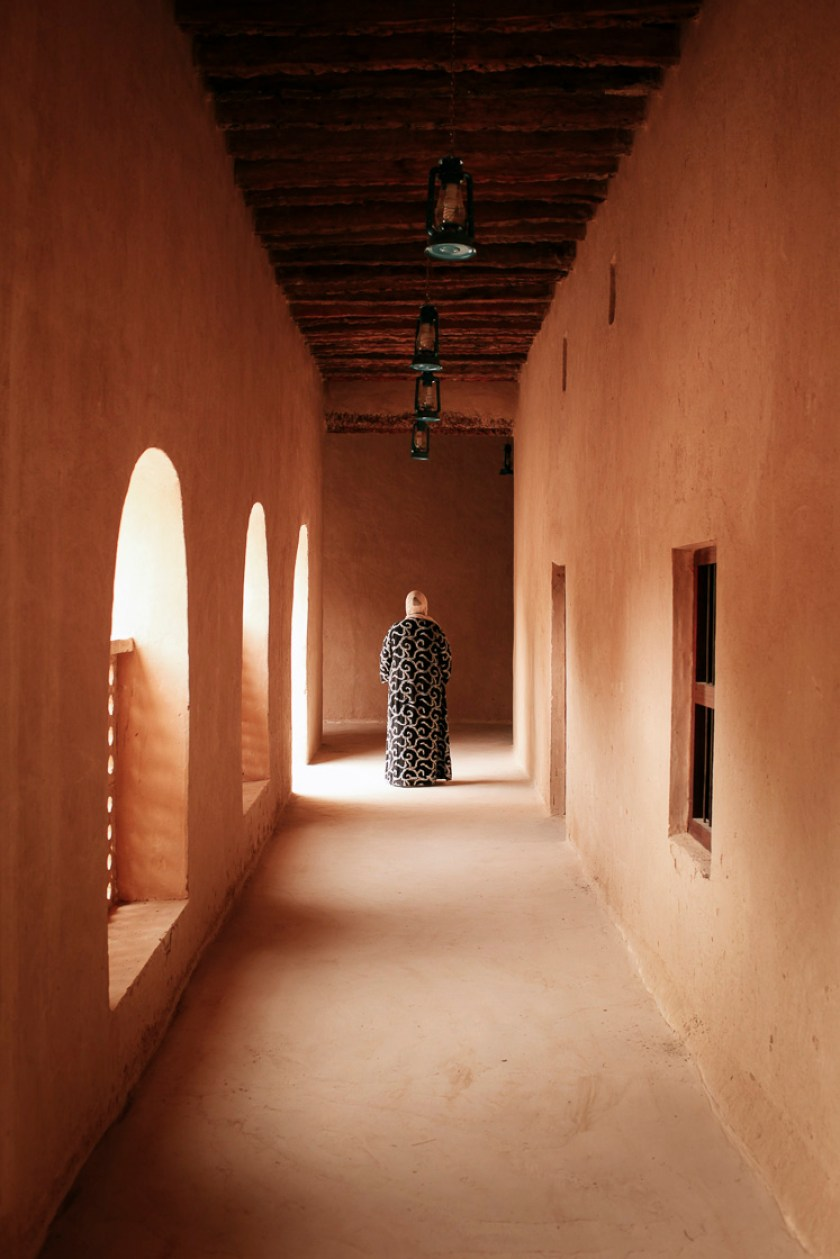 Woman in hijab at the end of a corridor