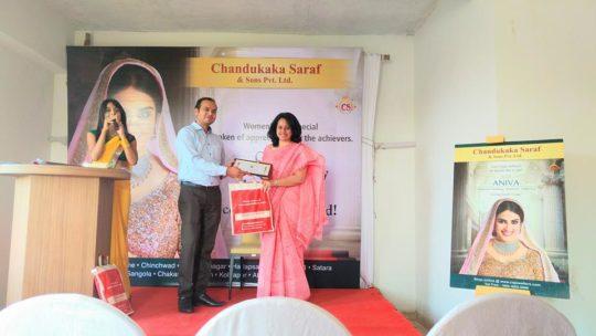 Adv Ritu Agwekar receving an award for her work