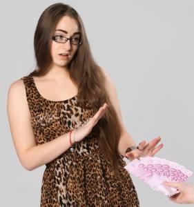 Hidden blocks to money - woman refusing cash