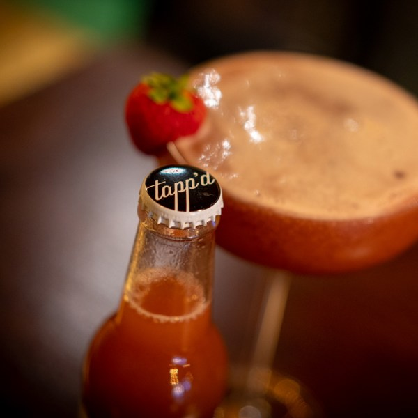 Strawberry Daiquiri ready to drink cocktail glass and bottled close up image