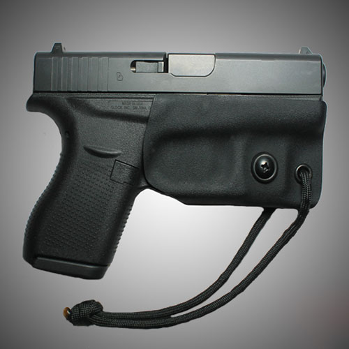Black IWB (Inside the Waist Band) Trigger Guard gun holster molded from black 0.80 kydex attached to a seven inch black 550 paracord for redundancy measures.