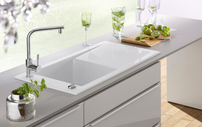 kitchen sink white cheap unfinished cabinets how to choose the best material for your tap warehouse a ceramic fireclay in high quality gloss finish with chrome mixer