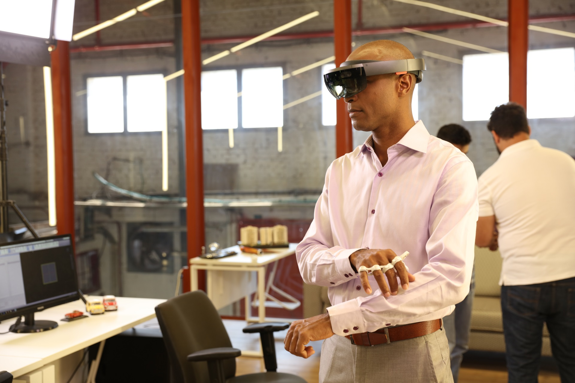 A man uses the Tap with his Hololens AR headset to navigate