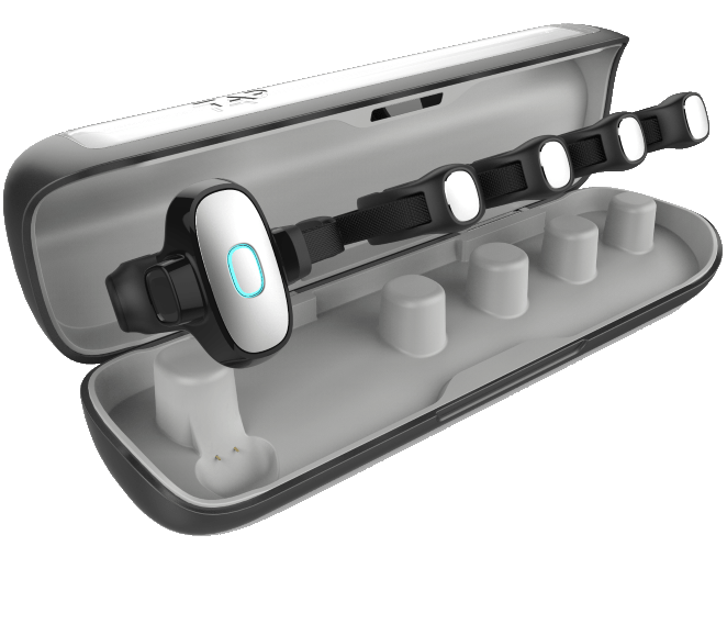 The Tap wearable keyboard and mouse inside it's protective charging case