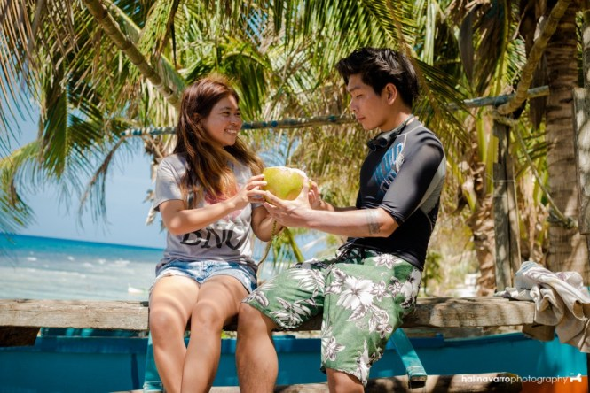 Sharing cocnuts in Tapwakan rock formation, Calayan Island